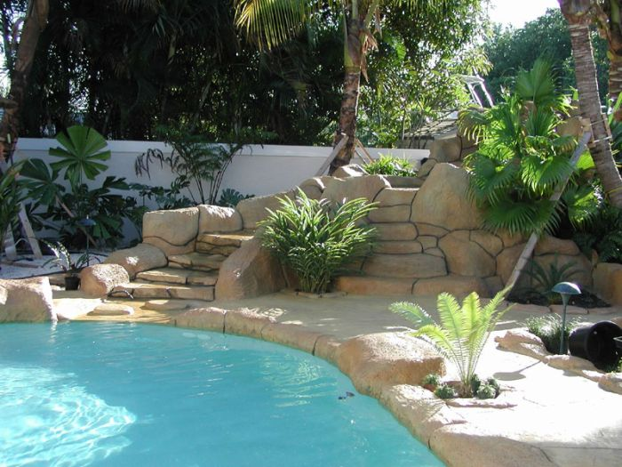 Boca raton pool builder john sammet offering caves and for Swimming pool waterfalls construction