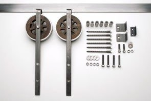 The Artisan Strap barn door hardware kit is a unique, and custom designed piece that captures the combination of steel and wood perfectly.